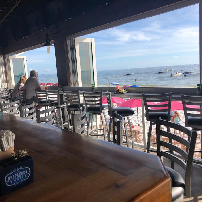 Seats along the chair rail in Shucker's at The Gulfshore offer a great vantage point of the action on Fort Myers Beach.