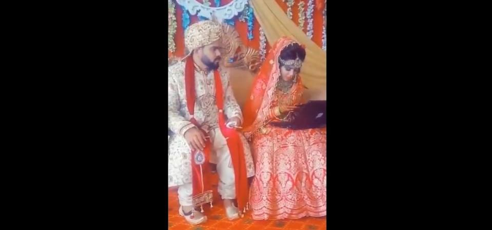 Screencap of bride occupied with her gadgets at her wedding.  —Twitter/@dineshjoshi70 pic
