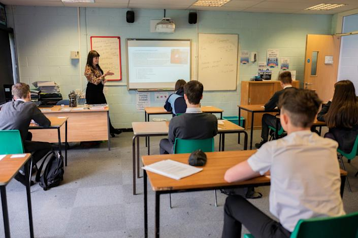 Pupils sit apart during a socially distanced language lesson on July 16 at Longdendale High School in Hyde, England.