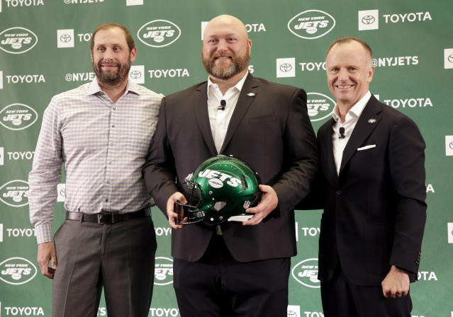 New Jets general manager Joe Douglas (middle), posing with head coach Adam Gase (left) and team CEO Christopher Johnson, promised a new day for the franchise. (AP)
