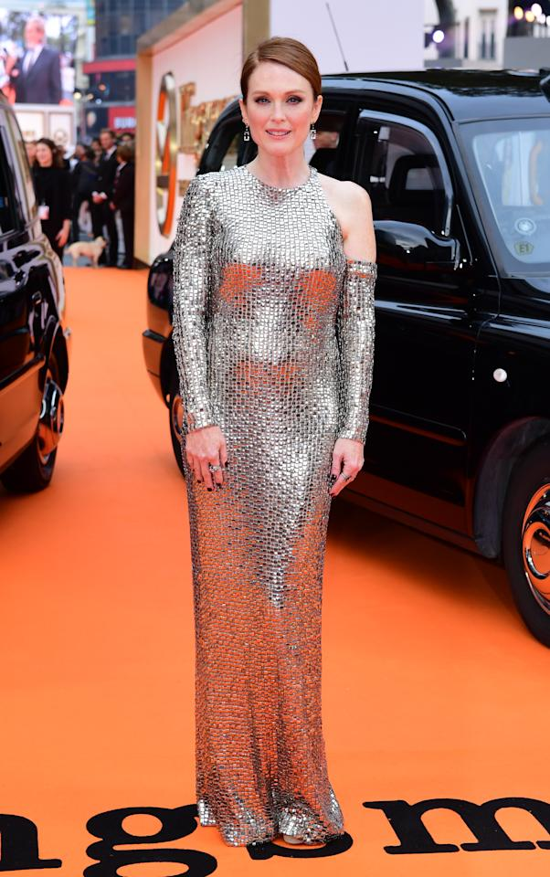 <p>56-year-old Julianne wowed in a metallic silver Tom Ford gown complete with a cold shoulder.<br /><i>[Photo: PA]</i> </p>