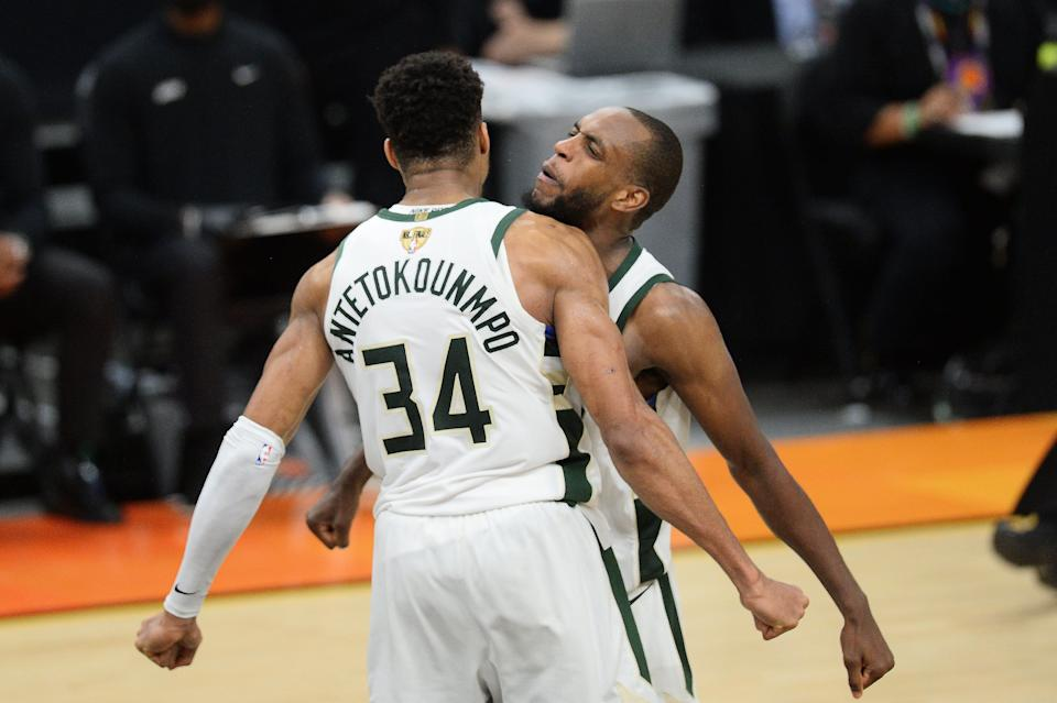 Milwaukee Bucks players Giannis Antetokounmpo and Khris Middleton celebrate after defeating the Phoenix Suns in Game 5.