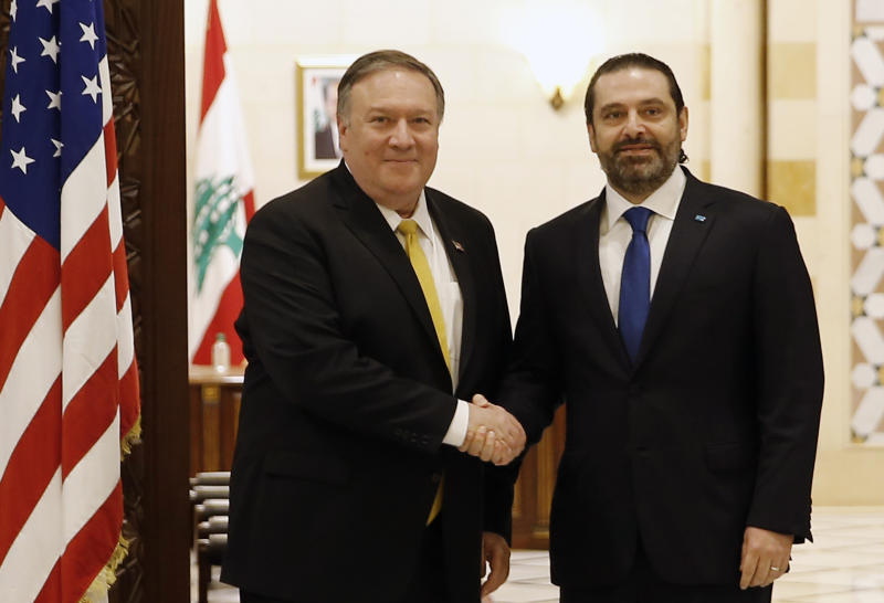 Lebanese Prime Minister Saad Hariri, right, shakes hands with U.S. Secretary of State Mike Pompeo, left, in Beirut, Lebanon, Friday, March. 22, 2019. Pompeo arrived in Lebanon on Friday amid strong regional condemnation of President Donald Trump's declaration that it's time the U.S. recognized Israel's sovereignty over the Israeli-occupied Golan Heights. (AP Photo/Bilal Hussein)