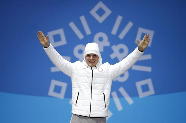 Medals Ceremony - Freestyle Skiing - Pyeongchang 2018 Winter Olympics - Men's Ski Cross - Medals Plaza - Pyeongchang, South Korea - February 21, 2018 - Bronze medalist Sergey Ridzik, an Olympic Athlete from Russia, on the podium. REUTERS/Kim Hong-Ji