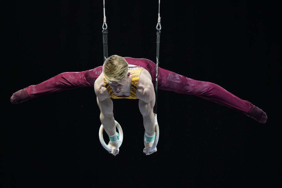 Shane Wiskus, representing the University of Minnesota, competes during the Winter Cup gymnastics event Friday, Feb. 26, 2021, in Indianapolis. The University of Minnesota and the University of Iowa will stop offering men's gymnastics as a scholarship sport at the end of the month. Wiskus wants to be part of the U.S. Olympic gymnastics team. It's one of the reasons he left Minnesota last fall for the U.S. Olympic and Paralympic Training Center in Colorado Springs, Colorado. (AP Photo/Darron Cummings)
