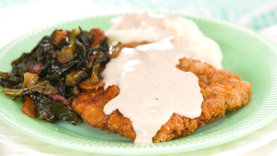 """<p><strong>Recipe: <a href=""""https://www.southernliving.com/dinner/country-fried-steak-recipe"""" rel=""""nofollow noopener"""" target=""""_blank"""" data-ylk=""""slk:Country Fried Steak"""" class=""""link rapid-noclick-resp"""">Country Fried Steak</a></strong></p> <p>Don't forget the homemade gravy! Make sure to reserve the remaining oil from cooking to incorporate into the mix. </p>"""