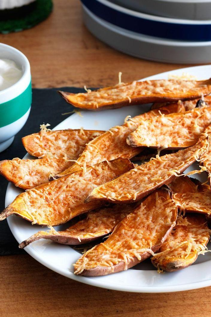 """<p>Everyone likes potato skins, and this cool new take on the classic app will take your party snacks to the next level. </p><p><strong><em><a href=""""https://www.womansday.com/food-recipes/food-drinks/recipes/a11250/sweet-potato-skins-recipe-122833/"""" rel=""""nofollow noopener"""" target=""""_blank"""" data-ylk=""""slk:Get the Sweet Potato Skins recipe."""" class=""""link rapid-noclick-resp"""">Get the Sweet Potato Skins recipe. </a></em></strong></p>"""