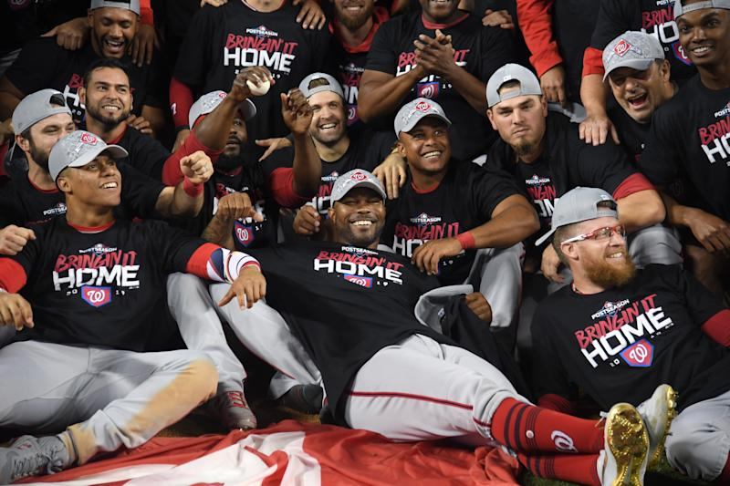LOS ANGELES, CALIFORNIA - OCTOBER 09: Howie Kendrick #47 of the Washington Nationals celebrates with his tam after defeating the Los Angeles Dodgers 7-3 in ten innings to win game five and the National League Division Series at Dodger Stadium on October 09, 2019 in Los Angeles, California. (Photo by Harry How/Getty Images)