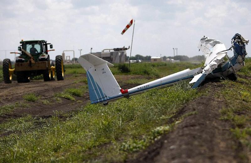 A tractor is driven away Monday, June 18, 2012, in Wallis, Texas, after a local landowner assisted first responders and National Transportation Safety Board investigators in removing a glider that crashed in a cotton field Sunday, killing three people including a 3-year-old boy. Authorities are trying to determine what led to the crash that happened at about 5 p.m. near the glider facility at Texas 36 and Cougar Drive Sunday evening. Deputies said Fred Blair, 68, of Wallis, and Matilda Blair, 32, and 3-year-old Andrew Blair of Houston died instantly in the crash. The Federal Aviation Administration is expected to investigate the incident, officials said. (AP Photo/Houston Chronicle ,Johnny Hanson)