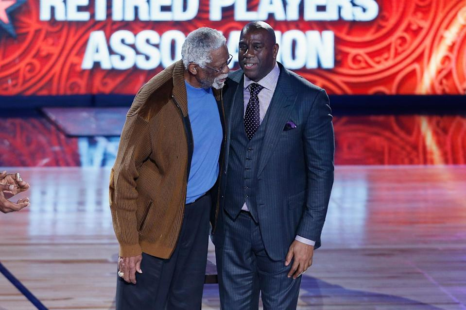 Magic Johnson was honored recently with Bill Russell, left, at the All-Star Game in New Orleans. (Getty Images)