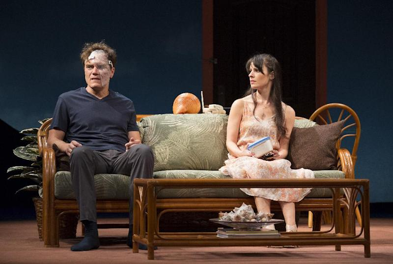 "This theater image released by The O + M Company shows Michael Shannon, left, and Kate Arrington during a performance of ""Grace,"" at the Cort Theatre in New York. (AP Photo/The O + M Company, Joan Marcus)"