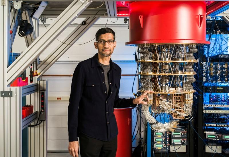 A handout picture shows Sundar Pichai with one of Google's Quantum Computers in the Santa Barbara lab