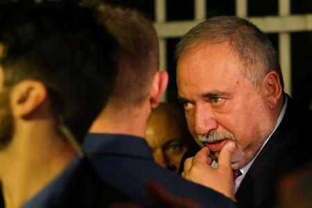 Avigdor Lieberman, leader of Yisrael Beitenu leaves his party headquarters following the announcement of exit polls in Israel's parliamentary election, in Jerusalem