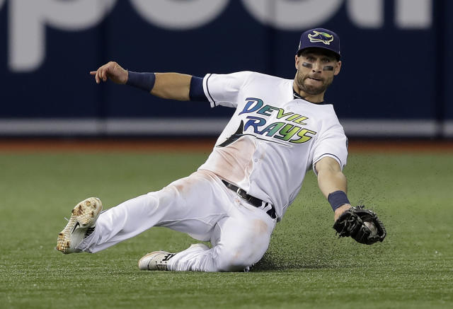 Tampa Bay Rays center fielder Kevin Kiermaier (39) makes a sliding catch on a flyout by New York Yankees' Brett Gardner during the third inning of a baseball game Saturday, June 23, 2018, in St. Petersburg, Fla. (AP Photo/Chris O'Meara)