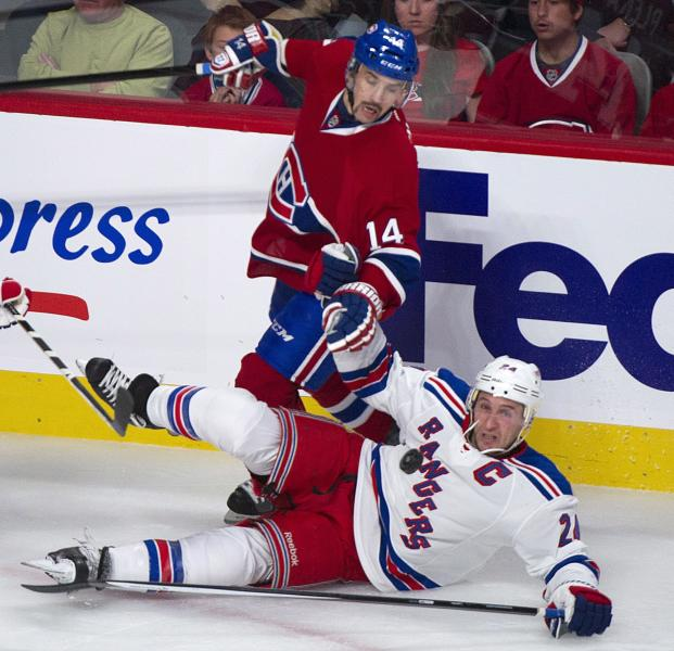 Montreal Canadiens' Tomas Plekanec, left, trips New York Rangers' Ryan Callahan during the second period of an NHL hockey game Saturday, Nov. 16, 2013, in Montreal. (AP Photo/The Canadian Press, Graham Hughes)
