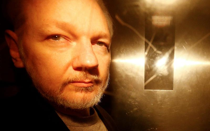 Julian Assange leaves Southwark Crown Court on May 1 - REUTERS