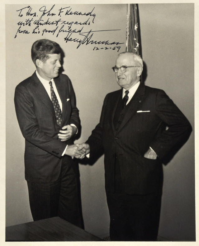 <p>This undated file photo provided by John McInnis Auctioneers shows a photograph of late Presidents John F. Kennedy, left, and Harry Truman, signed by Truman on Dec. 2, 1959. The photograph is part of a collection of John F. Kennedy memorabilia from the family of David Powers, a former special assistant to the president, that fetched almost $2 million at auction Sunday, Feb. 17, 2013 at John McInnis Auctioneers in Amesbury, Mass. (AP Photo/John McInnis Auctioneers, File)</p>