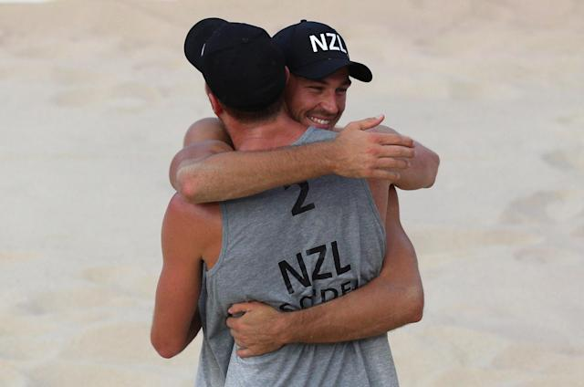 Beach Volleyball - Gold Coast 2018 Commonwealth Games - Men's Bronze Medal Match - England v New Zealand - Coolangatta Beachfront - Gold Coast, Australia - April 12, 2018. Ben O'Dea and Sam O'Dea of New Zealand celebrate. REUTERS/Athit Perawongmetha