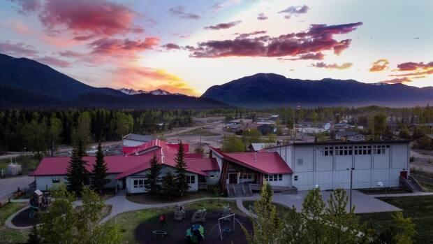 The Kwadacha First Nation's Aatse Davie School  will receive $486,000 for installing solar panels to help transition from diesel and propane to renewable energy.  (Aatse Davie School/Facebook - image credit)