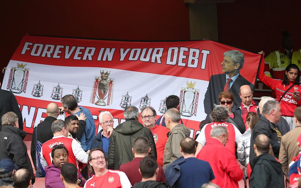 Some Arsenal fans show their support for Arsene Wenger - Credit: REX FEATURES