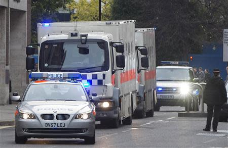 A police convoy of prison vans arrives at the Old Bailey, in London