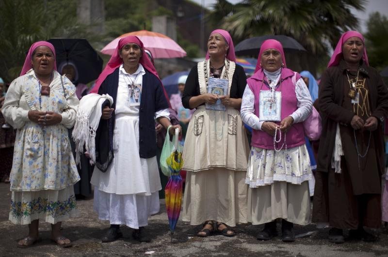 Faithful belonging to a religious group of followers of the Virgen del Rosario, listen to speeches against secular education in Nueva Jerusalen, Mexico, Monday, Aug. 27, 2012. Mexican authorities said talks continued Monday with both sect traditionalists who reject schools and reformists who want an education for their kids. (AP Photo/Alexandre Meneghini)
