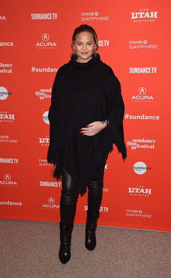 <p>Teigen wears a black-fringe poncho, leather pants, and black boots to the 2018 Sundance Film Festival in Park City, Utah. (Photo: Getty Images) </p>