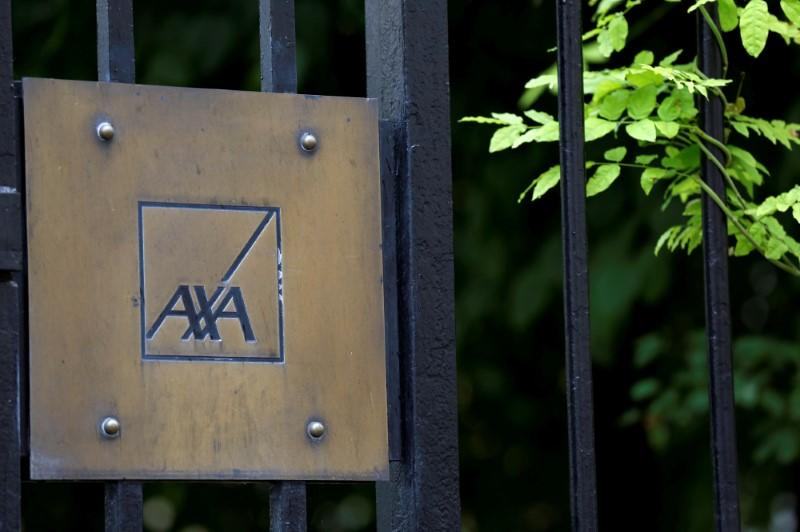 Logo of France's biggest insurer Axa is seen in front the company headquarter in Paris