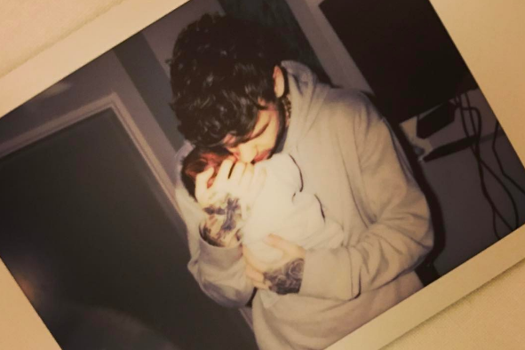 Newborn: Cheryl announced the news with a picture of her son being held by Liam