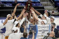 Drexel celebrates after a win over Elon in an NCAA college basketball game for the Colonial Athletic Association men's tournament championship in Harrisonburg, Va., Tuesday, March 9, 2021. (AP Photo/Daniel Lin)