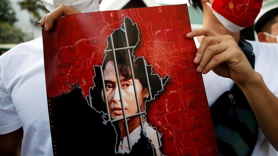 Picture of Aung San Suu Kyi`s face behind bars