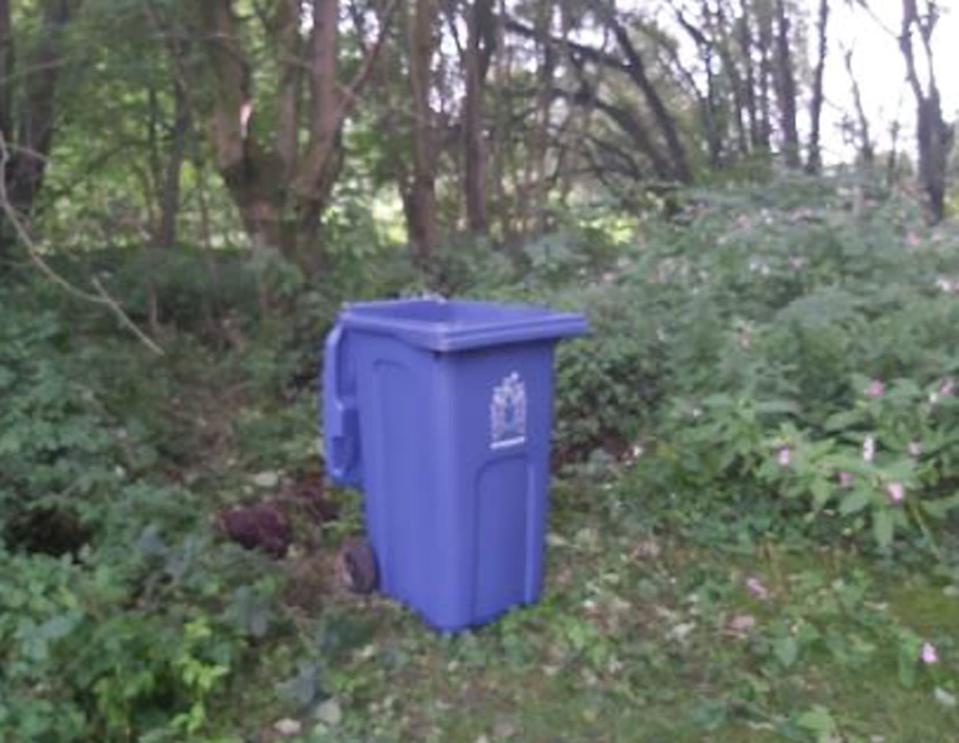 The blue wheelie bin found in the cemetery, which prosecutors said Price used to move Birbeck's body. (PA Images/Lancashire Constabulary)