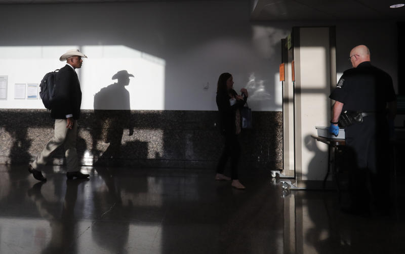 In this Wednesday, Sept. 25, 2019 photo, a secondary security check point is set up to screen anyone entering the hallway leading to the courtroom holding the murder trial for Amber Guyger at the Frank Crowley Courthouse in downtown Dallas. Security has been ramped up around the white former Dallas police officer's high-profile trial for murder in the killing of her unarmed black neighbor. The Dallas Police Association says threats have forced the group to hire private security for Guyger and her lawyers.   (AP Photo/LM Otero)