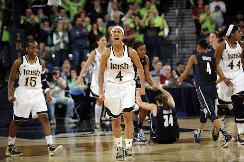 FILE - In this March 4, 2013, file photo, Notre Dame guard Skylar Diggins (4) celebrates a steal and the subsequent Connecticut foul during the third overtime of an NCAA college basketball game, Monday, March 4, 2013, in South Bend, Ind. Notre Dame was announced Monday, March 18, to join Connecticut, Stanford and Baylor as a No. 1 seed in the women's tournament, marking the second straight season those four schools were the top seeds. (AP Photo/Joe Raymond, File)