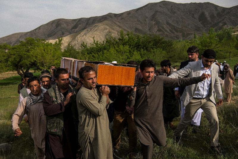 Relatives and friends of late AFP photographer Shah Marai carry his coffin at his burial outside Kabul (AFP Photo/Andrew Quilty)