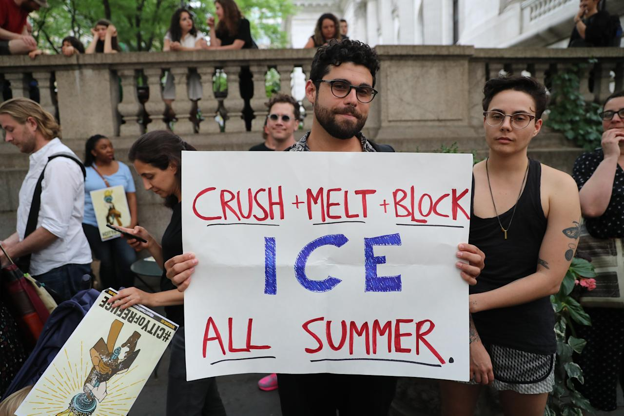 <p>A protester holds sign slamming I.C.E. on the terrace outside the New York Public Library on 42nd Street in New York City on June 20, 2018. (Photo: Gordon Donovan/Yahoo News) </p>