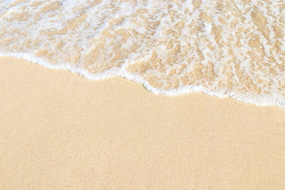 <p>Enjoy gentle waves lapping at the shore of a gorgeous white sand beach. </p>