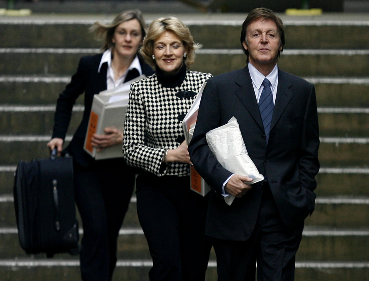 FILE - In this Tuesday, Feb. 12, 2008 file photo, Paul McCartney, right, arrives at the High Court in London after a lunch break in his divorce settlement hearing. Paul McCartney and Heather Mills were in court to reach a financial settlement in their acrimonious, high stakes divorce. McCartney turned 70 years of age Monday June 18, 2012. (AP Photo/Simon Dawson, File)
