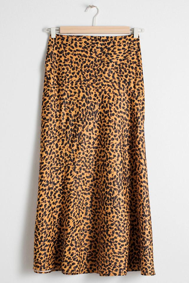 """<p><a class=""""body-btn-link"""" href=""""https://www.stories.com/en_gbp/clothing/skirts/product.satin-midi-skirt-leopard-print.0664383001.html"""" target=""""_blank"""">SHOP NOW</a></p><p>Just because the slip skirt is a staple doesn't mean it can't also be a statement piece.</p><p><em>Silk skirt, £59, & Other Stories</em></p>"""
