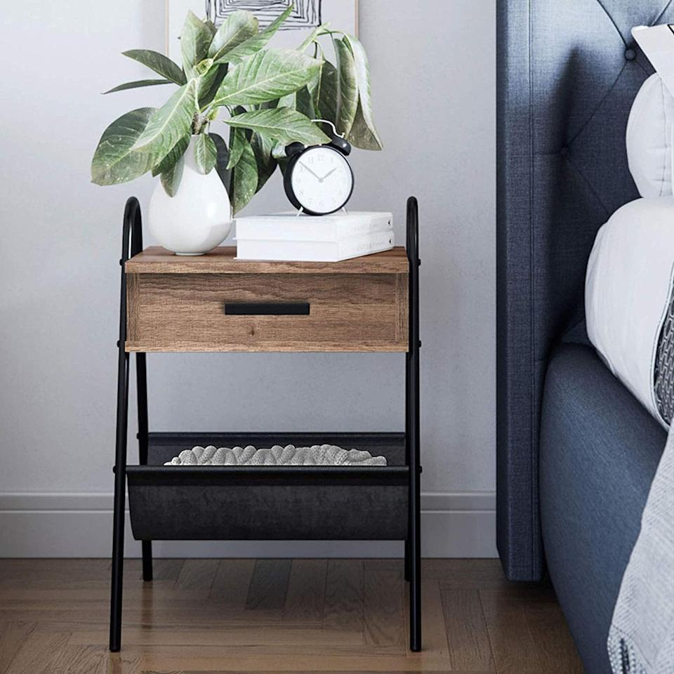 "<p>How cute is this <a href=""https://www.popsugar.com/buy/Nathan-James-Hugo-Nightstand-Accent-Rustic-Wood-Table-465714?p_name=Nathan%20James%20Hugo%20Nightstand%20Accent%20Rustic%20Wood%20Table&retailer=amazon.com&pid=465714&price=51&evar1=casa%3Aus&evar9=46356293&evar98=https%3A%2F%2Fwww.popsugar.com%2Fphoto-gallery%2F46356293%2Fimage%2F46356615%2FRustic-Table&list1=shopping%2Camazon%2Cfurniture%2Cbedrooms%2Chome%20shopping&prop13=api&pdata=1"" rel=""nofollow"" data-shoppable-link=""1"" target=""_blank"" class=""ga-track"" data-ga-category=""Related"" data-ga-label=""https://www.amazon.com/Nathan-James-32501-Nightstand-Accent/dp/B07J2DZWYD/ref=sr_1_17?keywords=modern+bedroom+furniture&amp;qid=1562696926&amp;s=gateway&amp;sr=8-17"" data-ga-action=""In-Line Links"">Nathan James Hugo Nightstand Accent Rustic Wood Table </a> ($51, originally $60)?</p>"