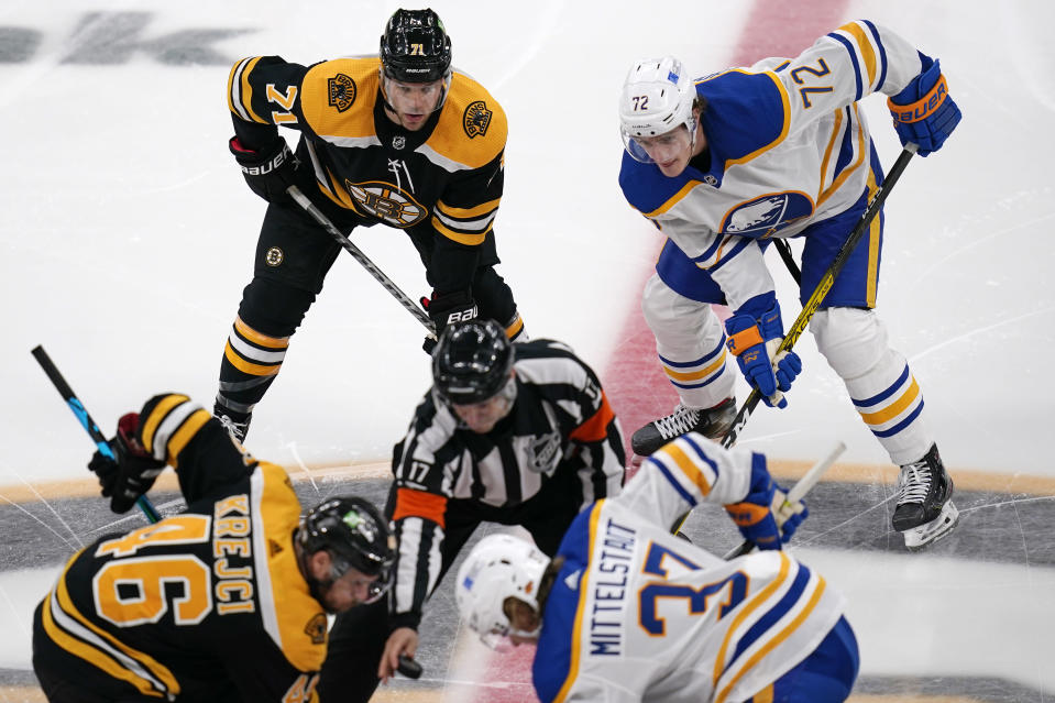Boston Bruins left wing Taylor Hall (71) waits next to Buffalo Sabres right wing Tage Thompson (72) at the opening faceoff of an NHL hockey game Tuesday, April 13, 2021, in Boston. (AP Photo/Charles Krupa)