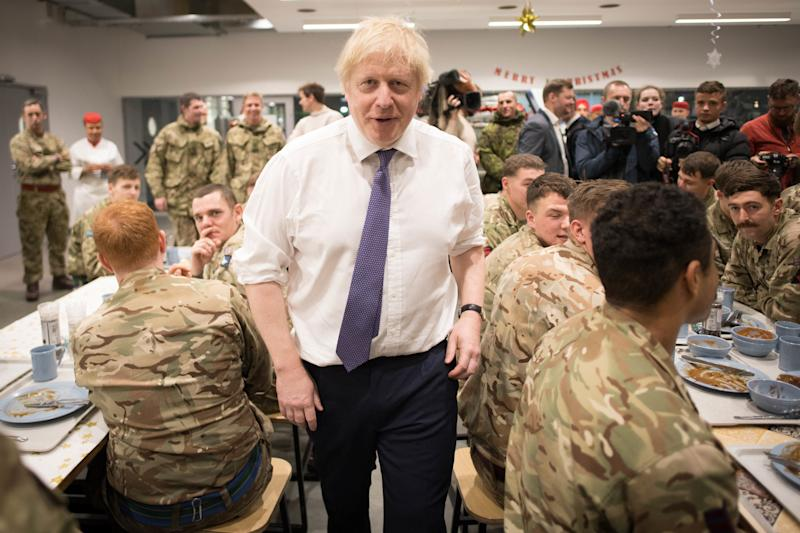 Prime Minister Boris Johnson meets soldiers after serving Christmas lunch to British troops stationed in Estonia during a one-day visit to the Baltic country. PA Photo. Picture date: Saturday December 21, 2019. The Prime Minister thanked the servicemen and women for their work as he joined them for lunch at the Tapa military base near the capital Tallinn. The base is home to 850 British troops from the Queen's Royal Hussars who lead the Nato battlegroup along with personnel from Estonia, France and Denmark. See PA story POLITICS Estonia. Photo credit should read: Stefan Rousseau/PA Wire