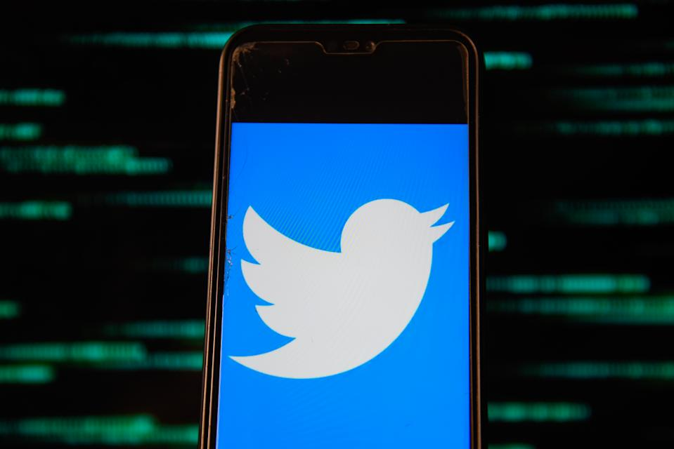 POLAND - 2020/07/15: In this photo illustration a Twitter logo is seen displayed on a smartphone. (Photo Illustration by Omar Marques/SOPA Images/LightRocket via Getty Images)