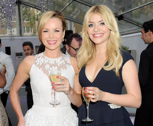 Amanda Holden (L) and Holly Willoughby arrive at the Glamour Women of the Year Awards in association with Pandora at Berkeley Square Gardens on May 29, 2012 in London, England. (Photo by Dave M. Benett/Getty Images)