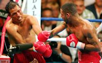 12. Diego Corrales TKO10 Jose Luis Castillo, May 7, 2005 – The first nine rounds were incredible, but the 10th is one of the all-time greats. Castillo knocked Corrales down twice early in the round and Corrales seemed like he may not be able to continue. Out of nowhere, he crushed Castillo with a straight right that essentially put Castillo out on his feet. He landed several more shots before referee Tony Weeks jumped in to halt it and give him the improbable win. (Photo credit: Getty)