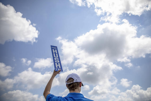 "Jack Ackermann, of Lexington, Ky., holds a, ""Hush, Y'all"" sign at the 18th green during the second round of the Barbasol Championship golf tournament at Keene Trace Golf Club in Nicholasville, Ky., Friday, July 19, 2019. (Ryan C. Hermens/Lexington Herald-Leader via AP)"