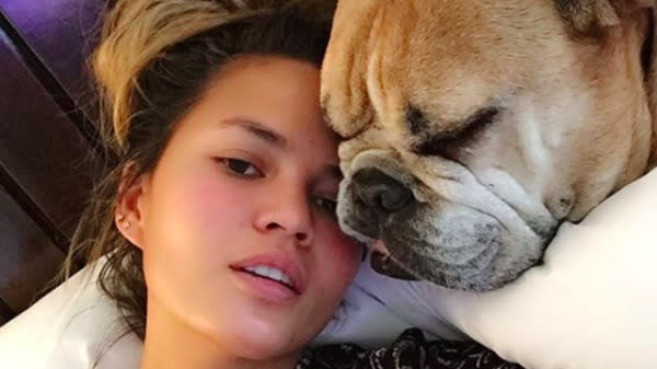 """Chrissy Teigen said that her beloved bulldog Puddy is suffering from heart failure, and she asked followers on Twitter to send """"happy doggy thoughts."""""""