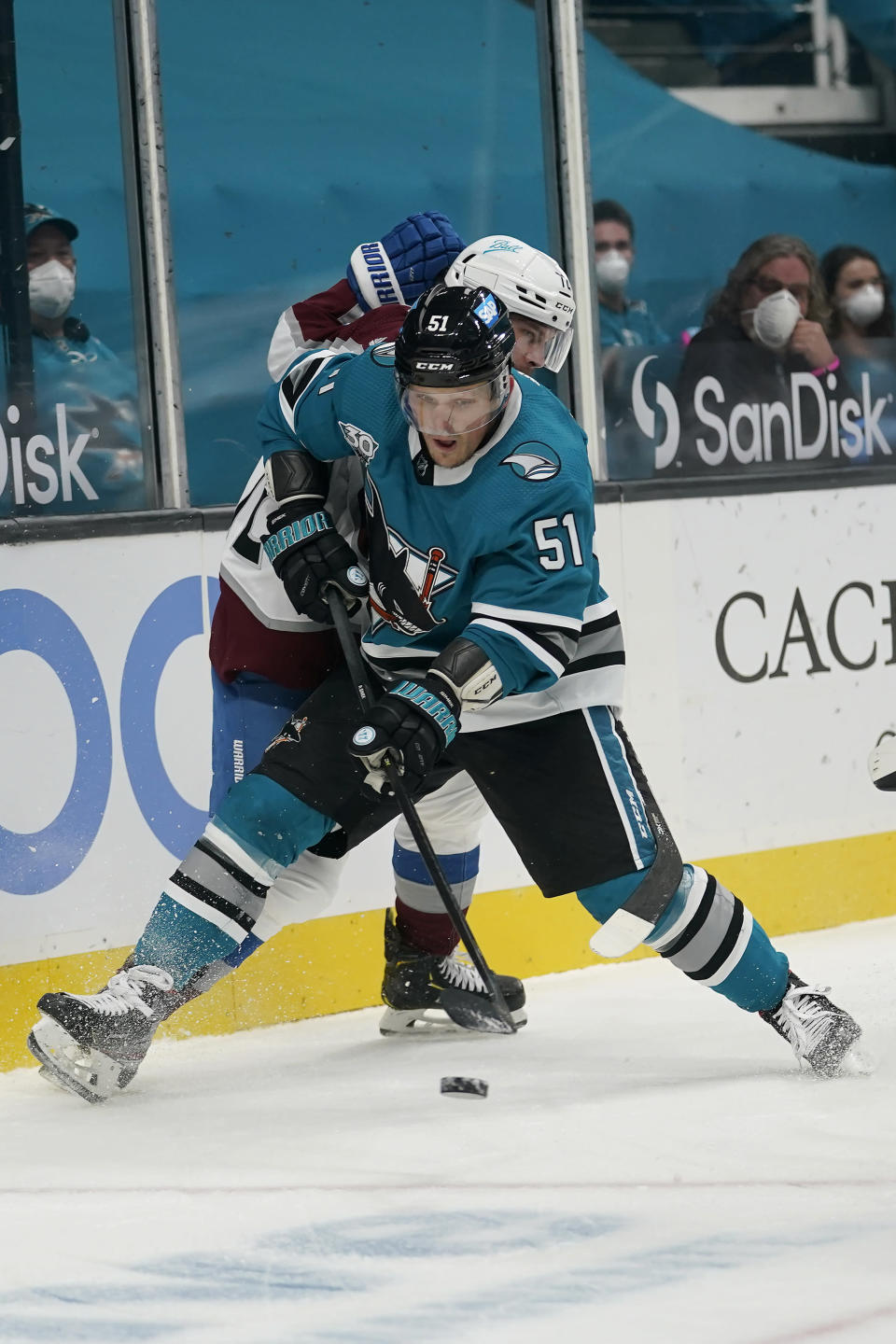 San Jose Sharks defenseman Radim Simek (51) reaches for the puck in front of Colorado Avalanche right wing Joonas Donskoi during the second period of an NHL hockey game in San Jose, Calif., Monday, March 1, 2021. (AP Photo/Jeff Chiu)