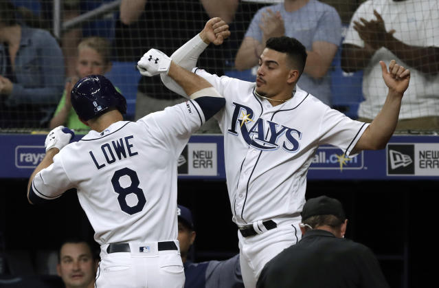 Tampa Bay Rays' Brandon Lowe (8) celebrates with Willy Adames after Lowe hit a three-run home run off Baltimore Orioles pitcher David Hess during the first inning of a baseball game Wednesday, April 17, 2019, in St. Petersburg, Fla. (AP Photo/Chris O'Meara)