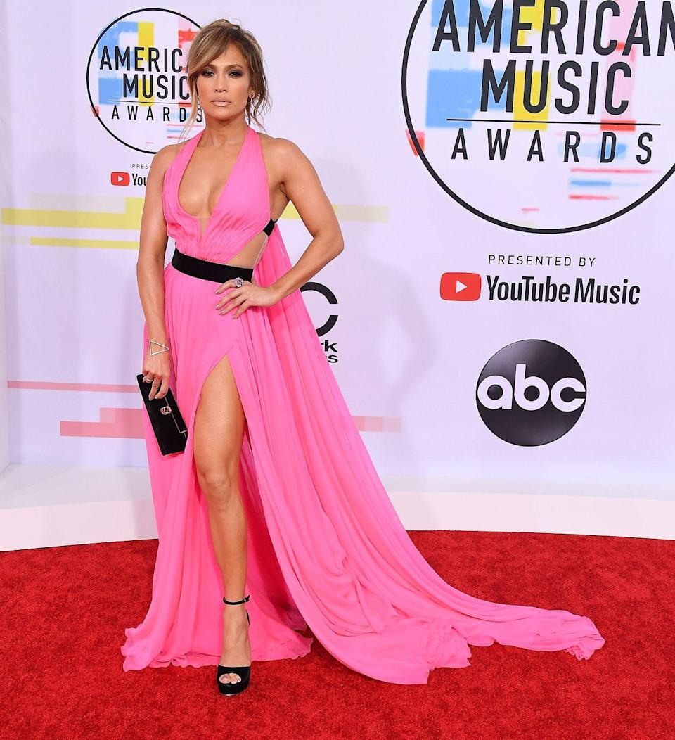 <p>Her 2018 American Music Awards' dress was a bit less out-there, but no less sexy, instead werking a Barbie pink tone.</p>